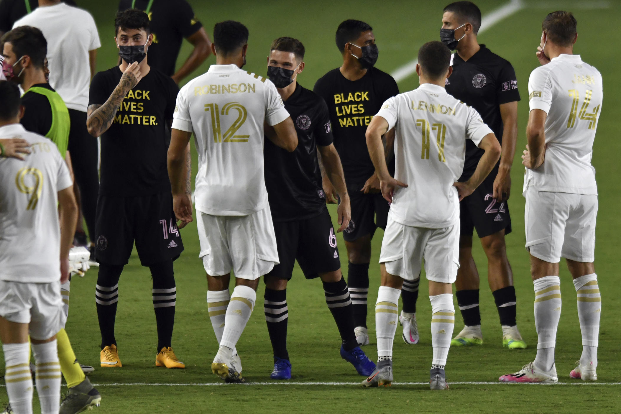 Players from Inter Miami and Atlanta United gather on the field before the postponement of their MLS soccer match Wednesday, Aug. 26, 2020, in Fort Lauderdale, Fla.