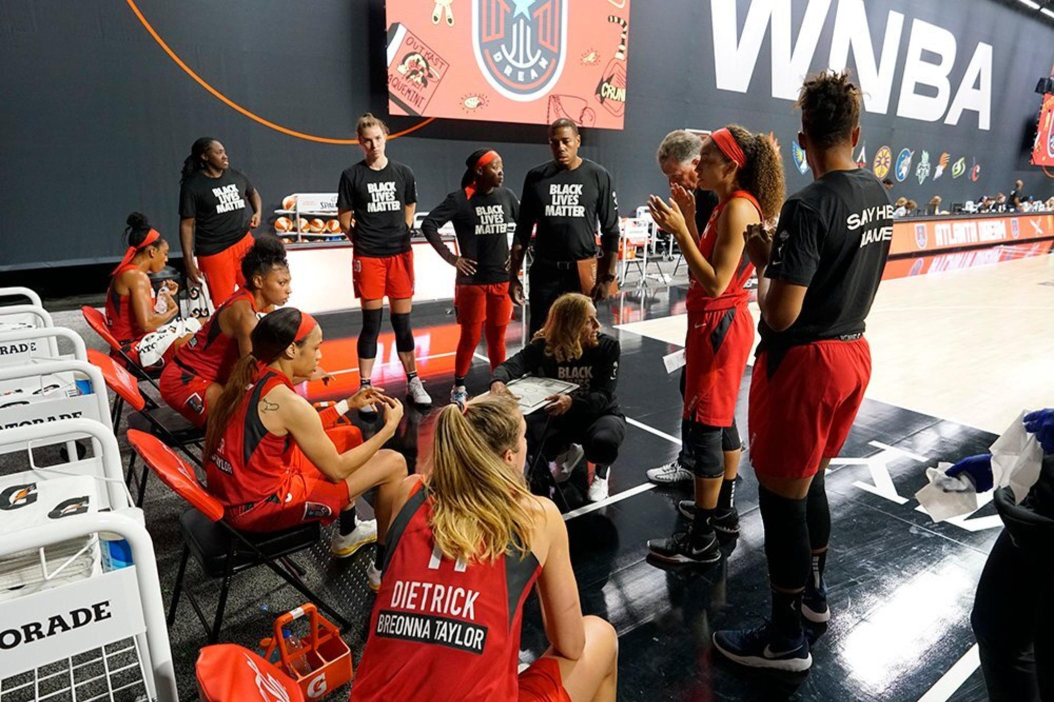 Members of the WNBA's Atlanta Dream wear clothing in solidarity with Black Lives Matter.