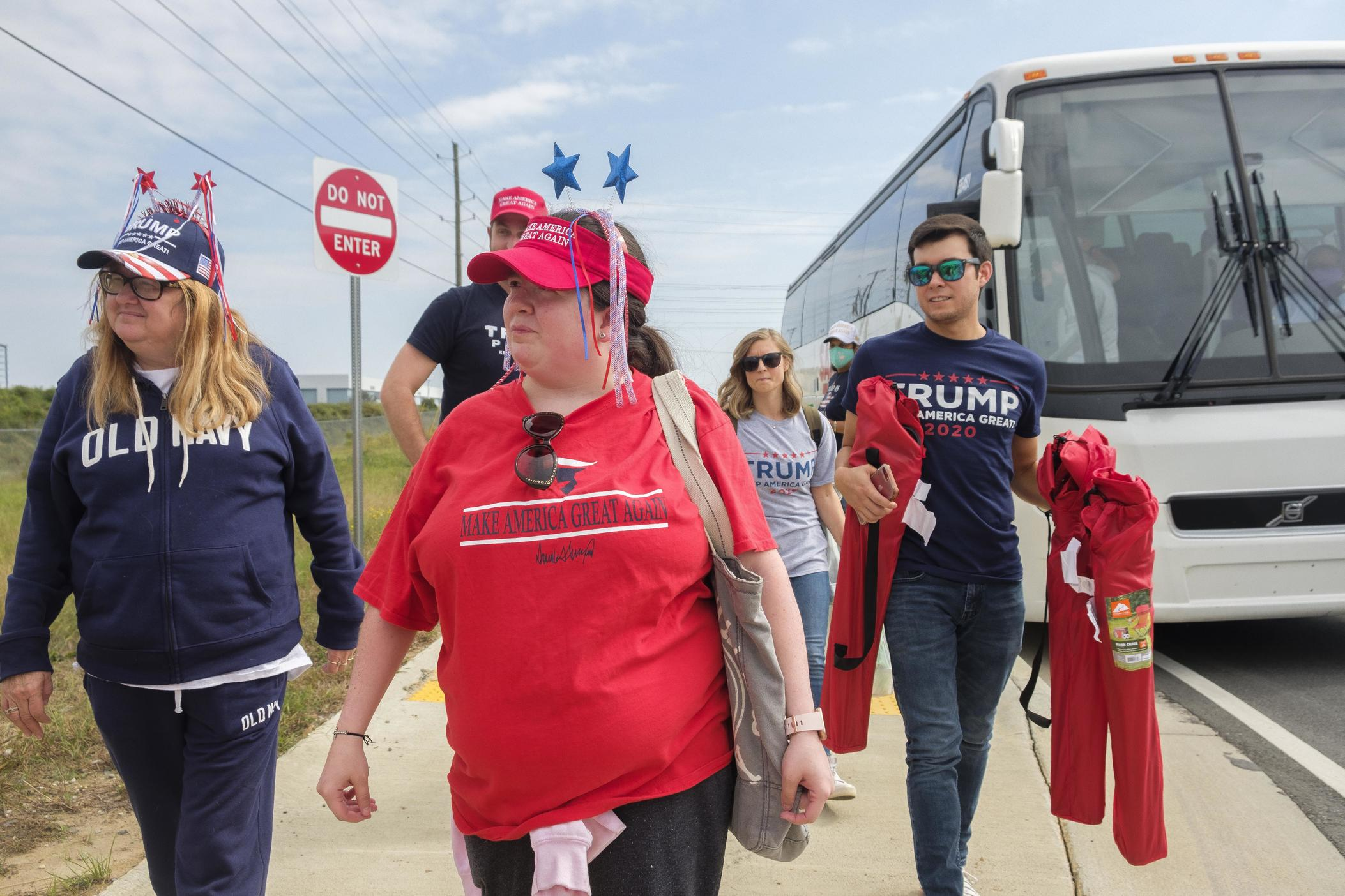 Trump supporters head into the mask-mandatory rally at the Middle Georgia Regional Airport on Friday afternoon, Oct. 16, 2020.