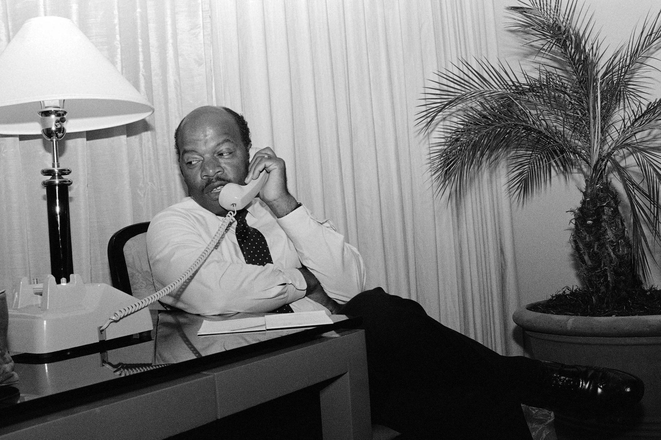 John Lewis talks on the telephone from his Atlanta hotel room Tuesday night, Sept. 2, 1986 prior to claiming victory by defeating Julian Bond in a runoff election for the fifth Congressional District seat in Georgia.
