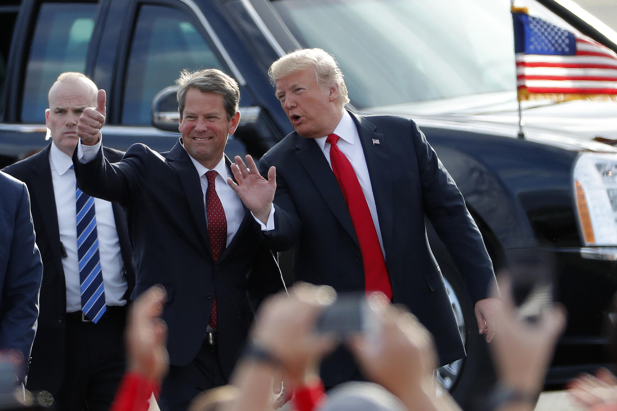 "In this Nov. 4, 2018, file photo, then-Georgia Republican gubernatorial candidate Brian Kemp, left, walks with President Donald Trump as Trump arrives for a rally in Macon , Ga. President Trump said Sunday, Nov. 29, 2020 he was ""ashamed"" for endorsing the Republican governor of Georgia after he lost in the state to Democrat Joe Biden."
