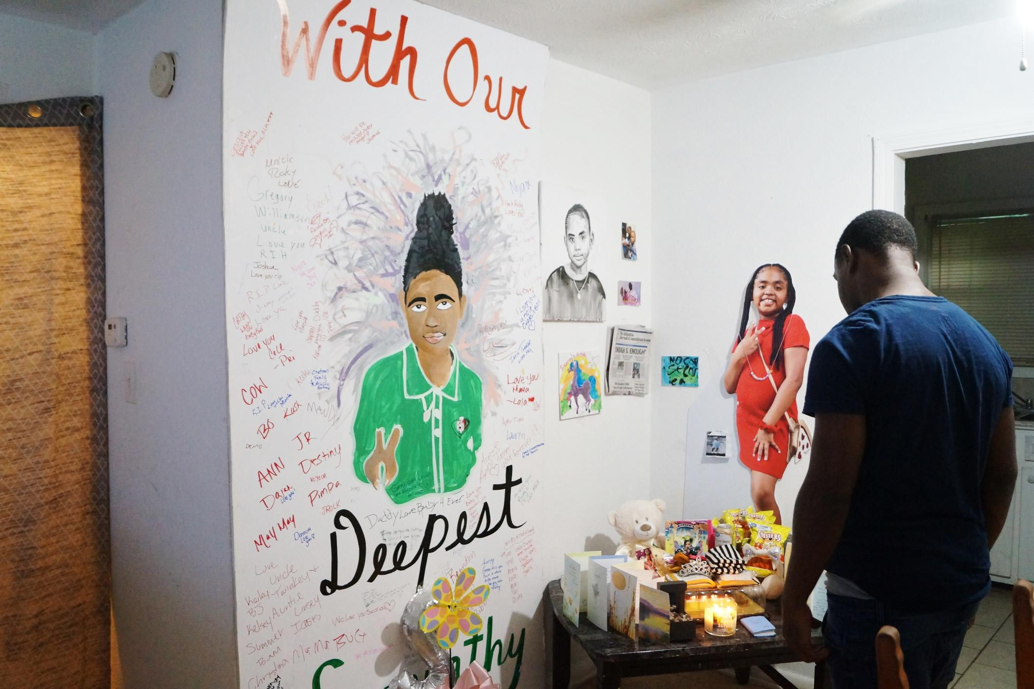 Secoriey Williamson stands in front of his memorial for his daughter Secoriea in the living room of his apartment in August.