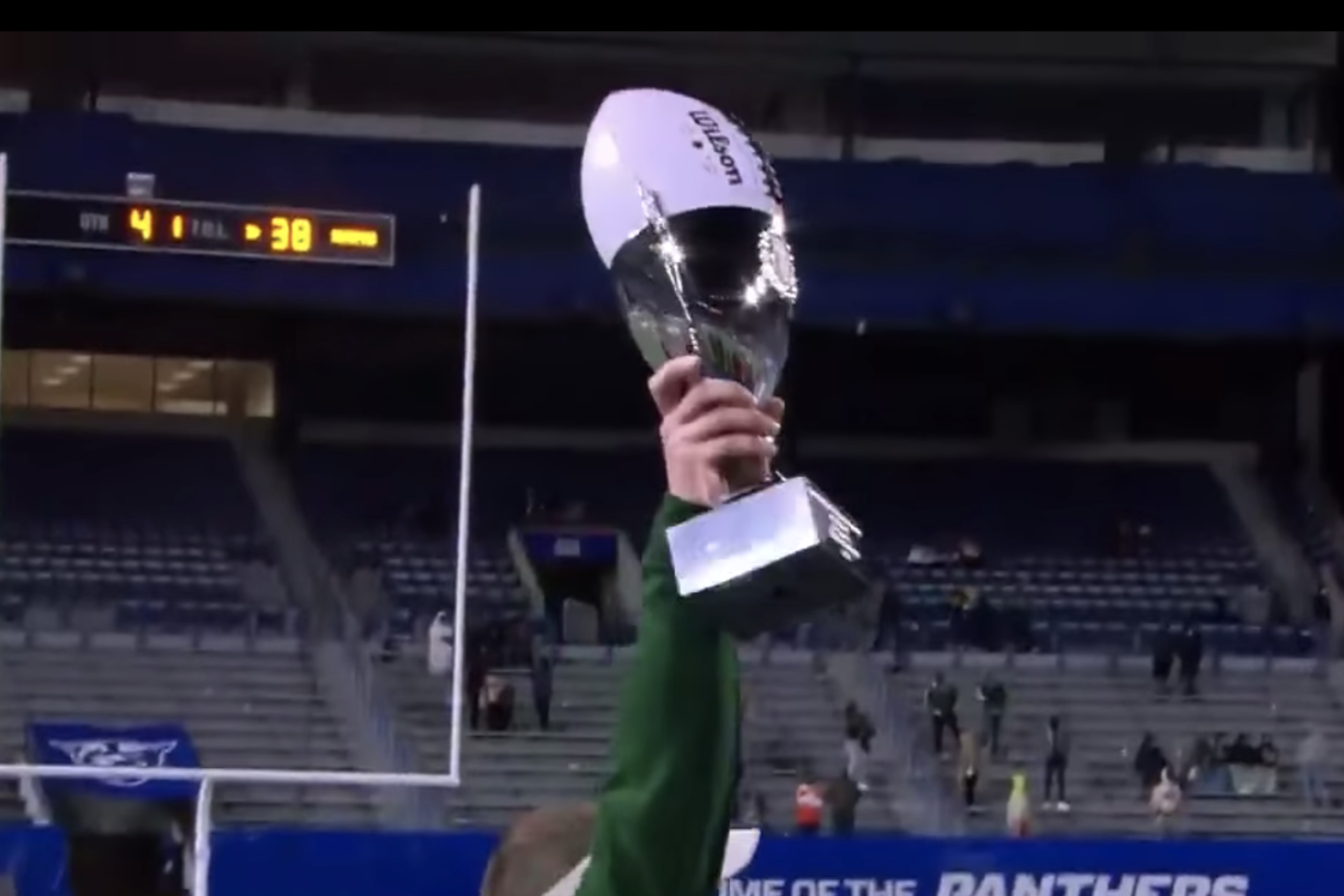 Adam Carter, coach of Grayson High School, holds the GHSA 2020 championship trophy for Class 7A.