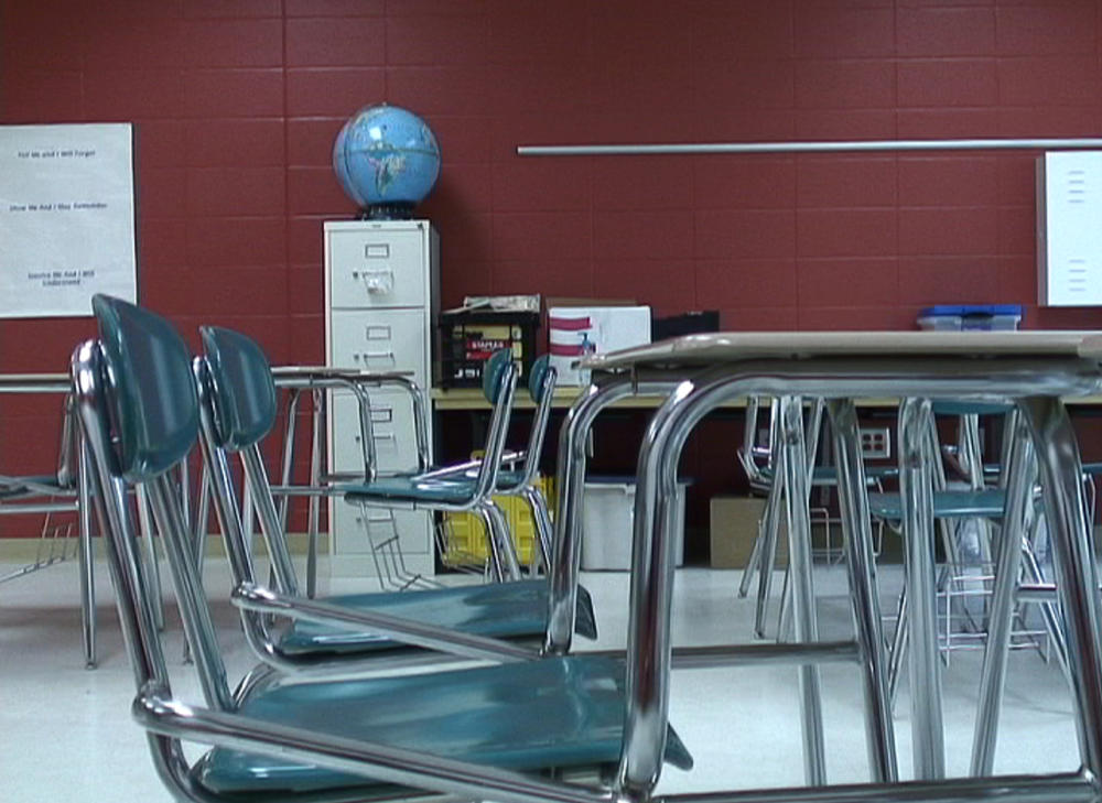 Empty desks in a public school in this file photo from 2010.