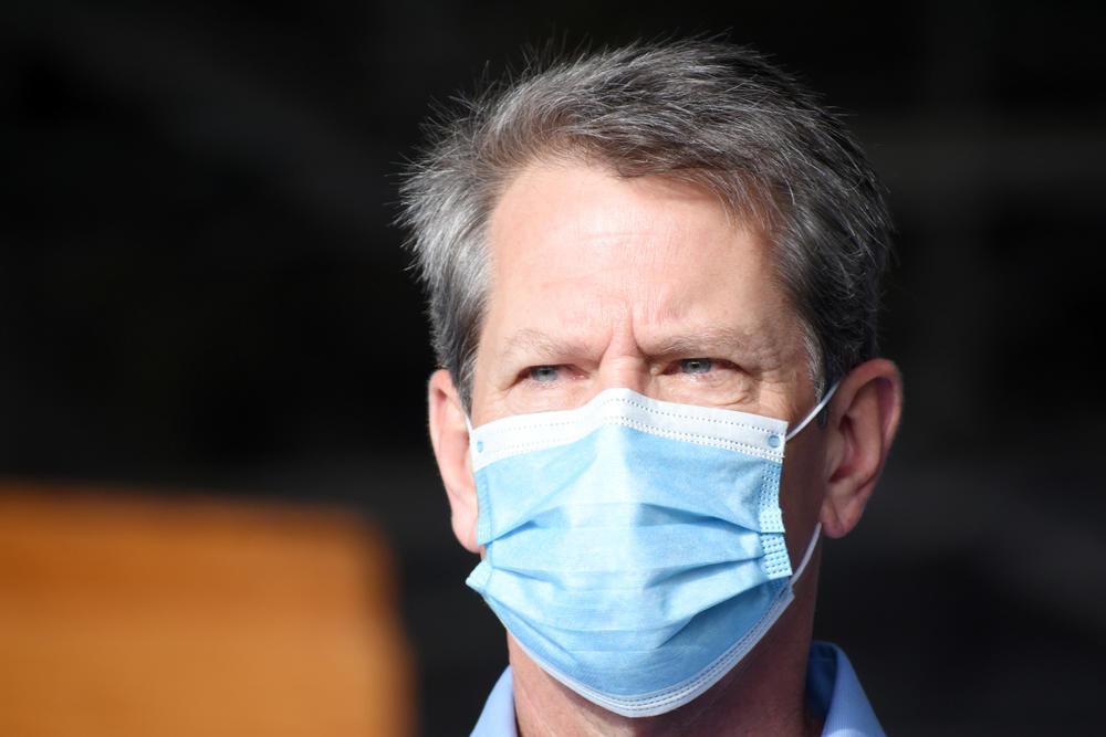 Gov. Brian Kemp wears a mask.