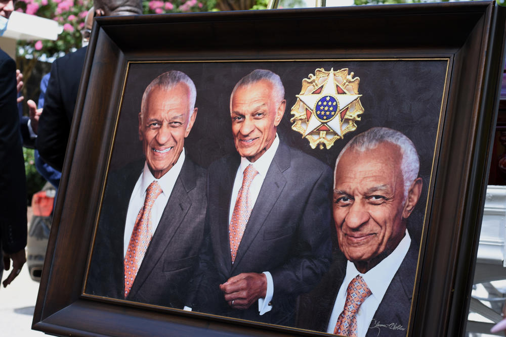 A portrait of the late Rev. Dr. C.T. Vivian is on display next to his casket.