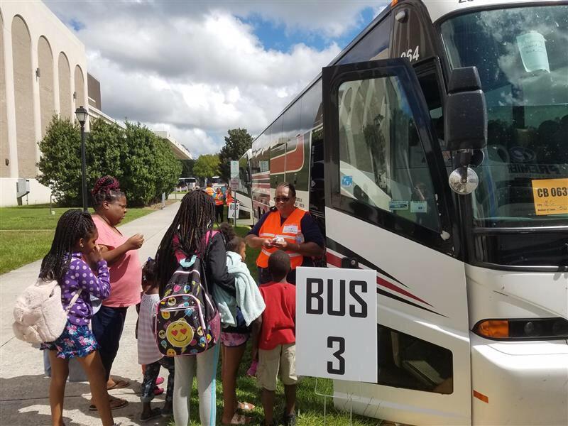 Evacuees board buses outside the Savannah Civic Center heading to Augusta ahead of Hurricane Dorian.