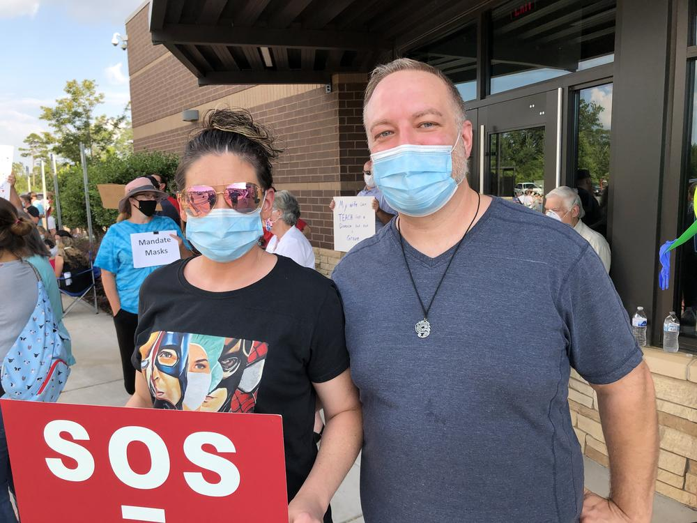 Nikki Crites (left) and Jamie Chambers demonstrate on behalf of Cherokee County educators Thursday July 16, 2020, in Canton.