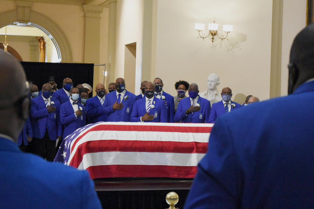 Members of the Phi Beta Sigma fraternity honor Rep. John Lewis in an Omega Ceremony at the Georgia State Capitol.