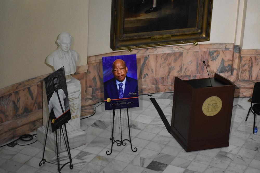 A picture of Lewis stands by the podium where state officials gave speeches on Lewis in the state capitol.