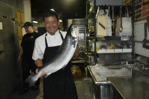 Chef Tano Phommasith of Carrollton's Little Hawaiian prepares a fresh fish for his hungry customers.