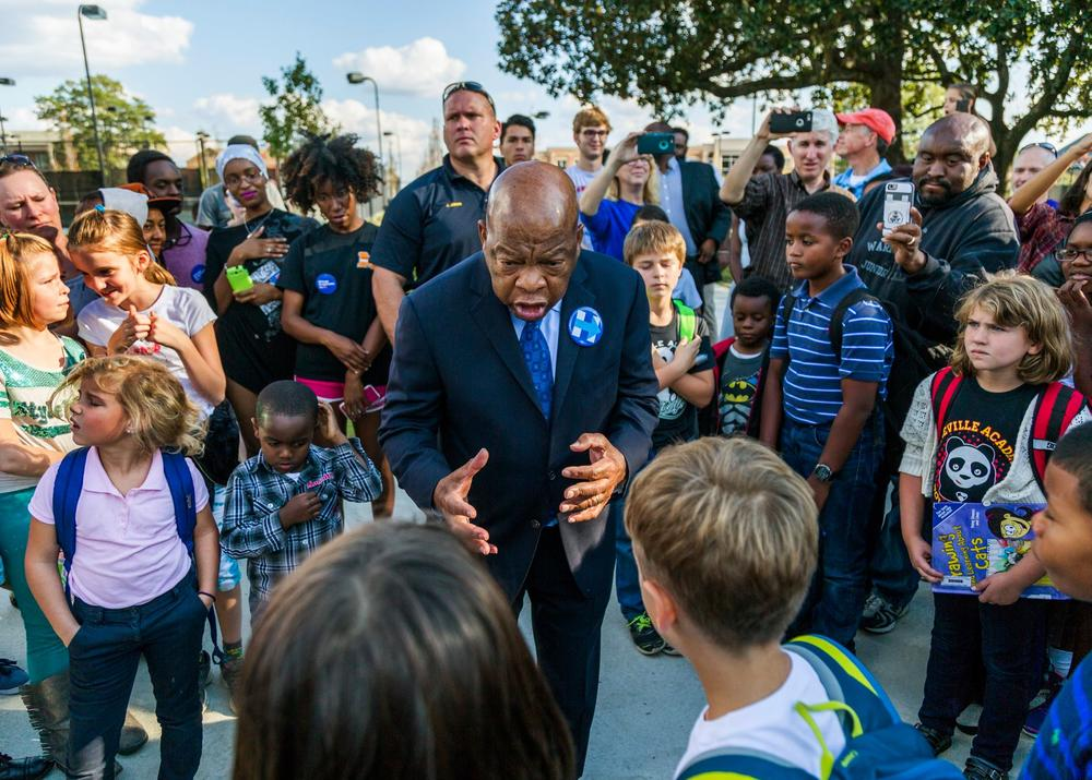 """John Lewis tells """"the chicken story"""" — about how he used to preach to his chickens — to children in Macon, Georgia."""
