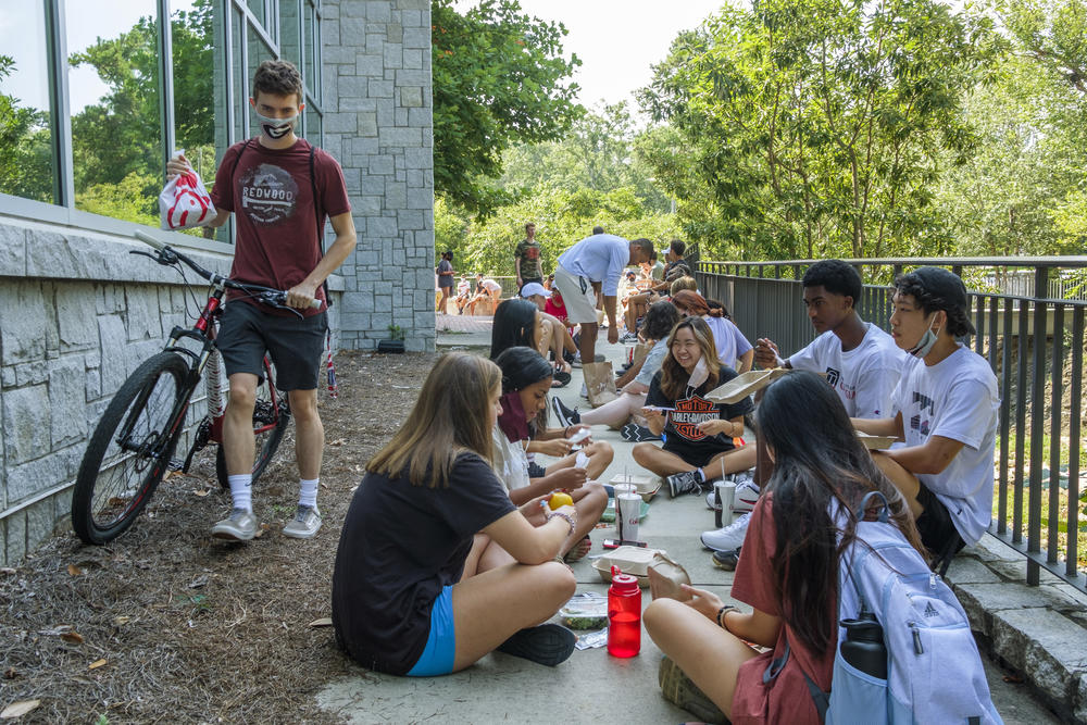 University of Georgia freshmen eat lunch behind one of the main dining halls where inside dining is by reservation only.