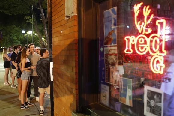 People wait to enter bar in Athens, Georgia.