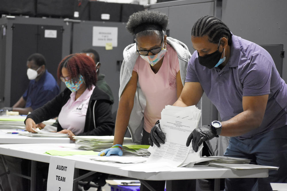 Fulton County election workers sort absentee ballots during a pilot audit after the June 9 primary.