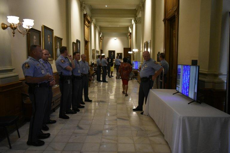 Georgia State Patrol officers monitor the tote board in June as state lawmakers approved legislation to create new protections for them.