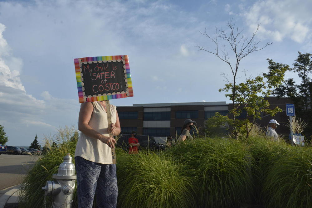 Woman in Cherokee County protest plan for schools to reopen.