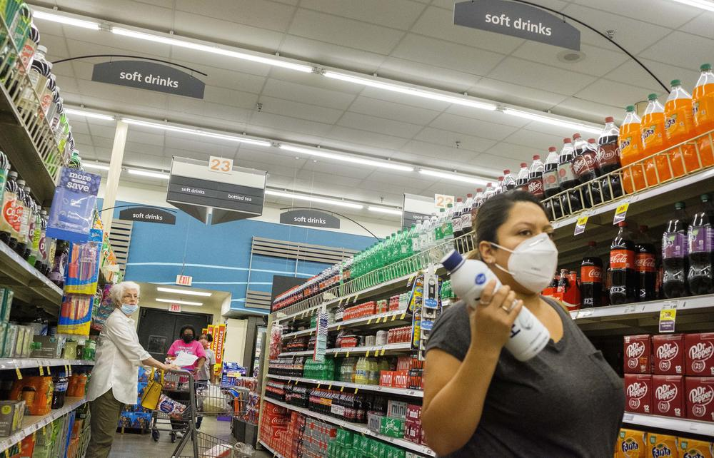 Shoppers with various takes on mask use in a grocery store in Macon on August 4, 2020.