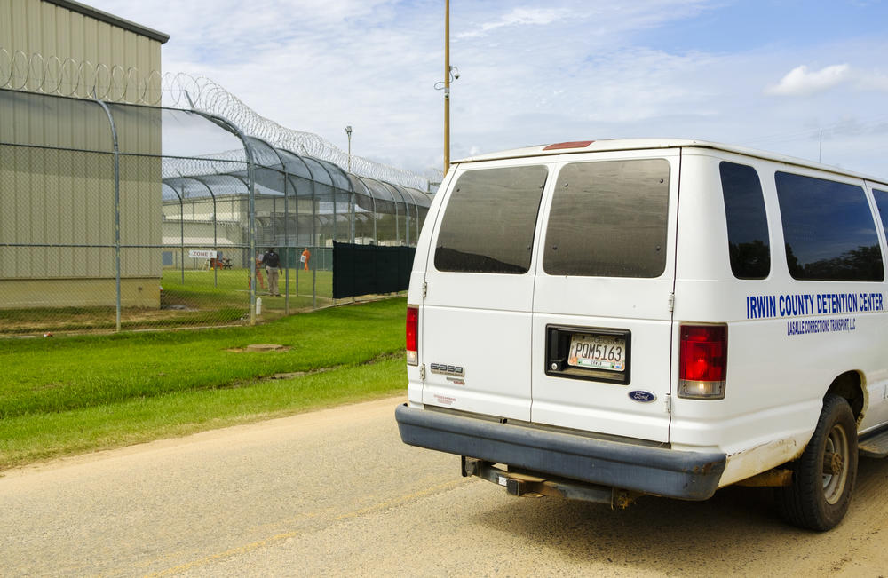 A van drives by inmates at the Irwin Center Detention Center Wednesday Sept. 25, 2020.