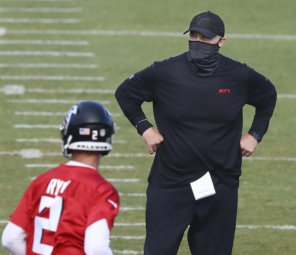 Atlanta Falcons head coach Dan Quinn watches over NFL football training camp on Wednesday, Aug. 19, 2020, in Flowery Branch, Ga.