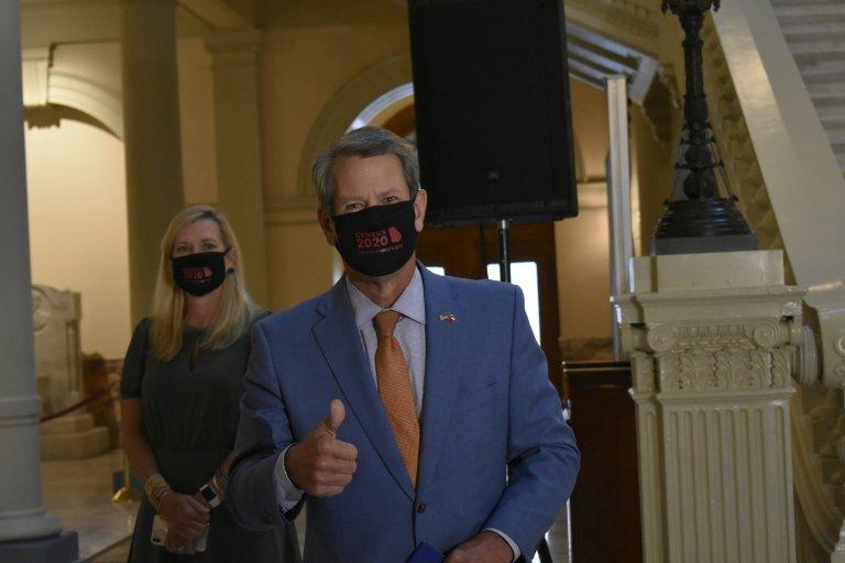 Gov. Brian Kemp and first lady Marty Kemp enter the Capitol with 2020 Census face masks. Kemp is seeking to boost the state's participation rate as the Sept. 30 deadline looms.