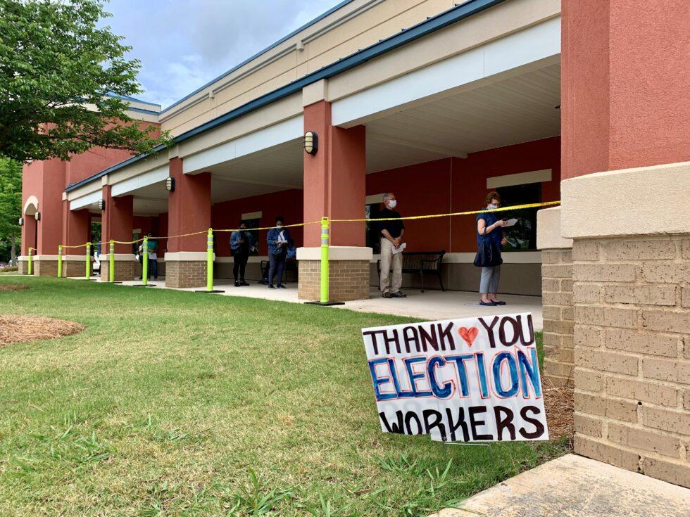 Voters wait in line at a precinct in Cobb County on May 18, 2020.