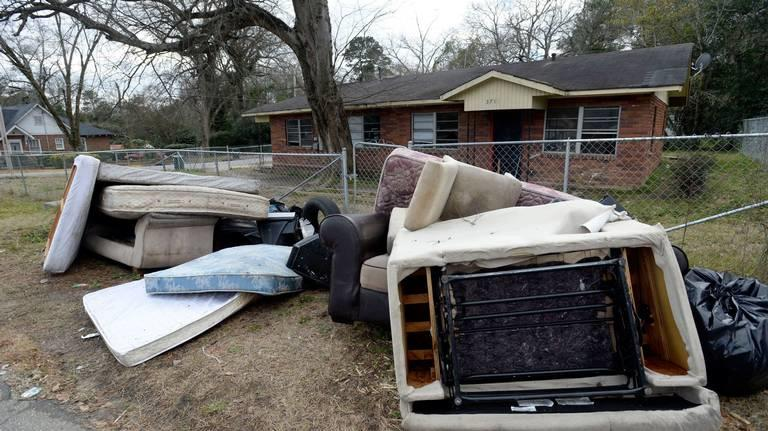 Furniture and other belongings sit at the curb after the Magistrate Court Sheriff's office supervised a court ordered eviction on Del Park in late January 2019.