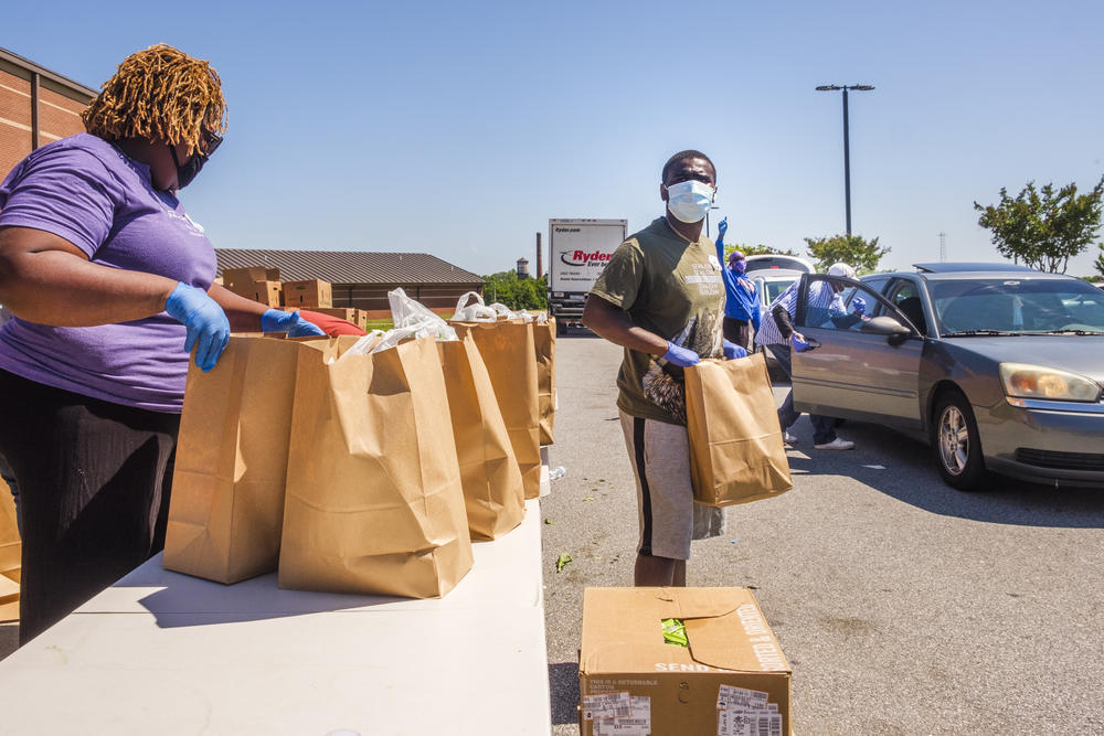 Volunteers in Macon hand out food