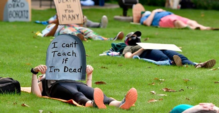 """Students and teachers attend a """"die-in"""" on the campus of Georgia College and State University in Milledgeville."""