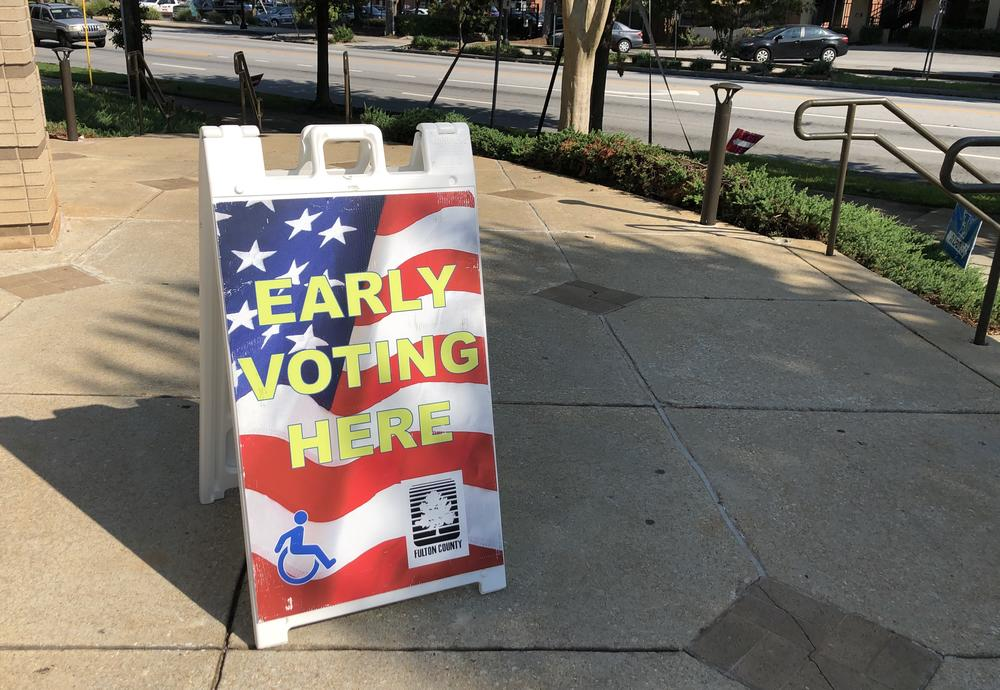 A sign for early voting outside of a polling location in Atlanta.