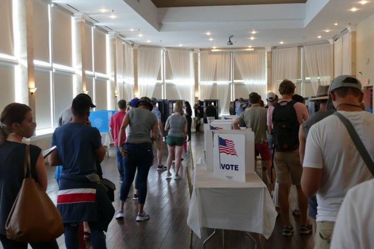 Voters line up at Park Tavern voting precinct for election in June 2020.