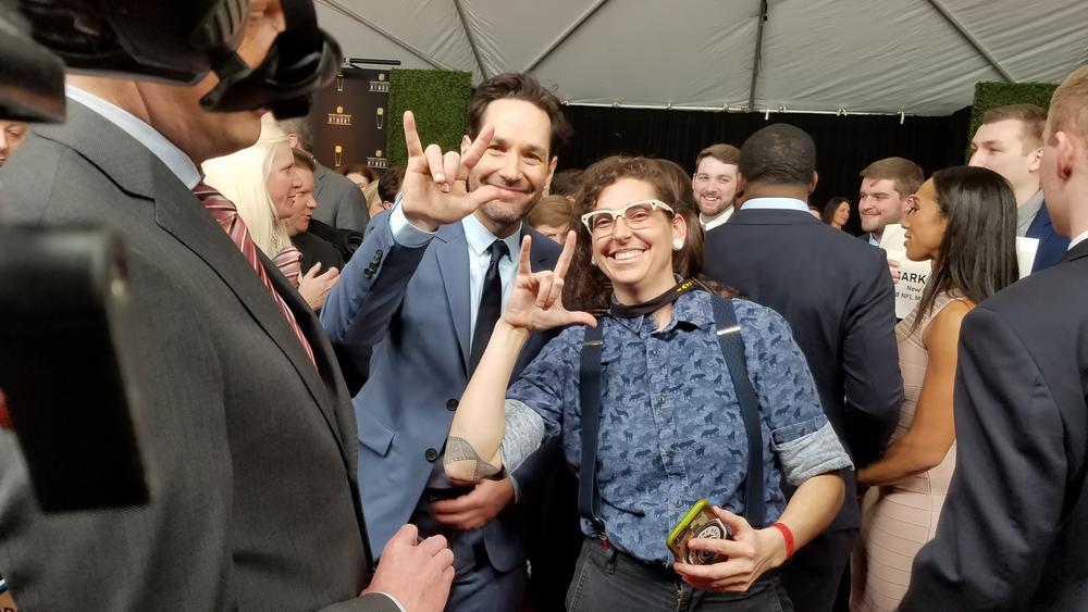 "Sign1News staff Martha signs ""I love you"" with actor Paul Rudd."