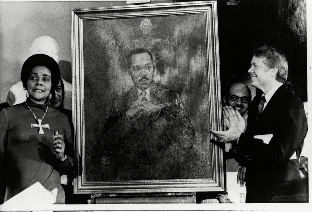 Coretta Scott King, widow of slain civil rights leader Dr. Martin Luther King, Jr., speaks at an unveiling of a portrait of Dr. King by artist George Mandus, Feb. 18, 1974, and dedicated by Gov. Jimmy Carter. It is the first portrait of an African American to be represented in the state's official portrait gallery.