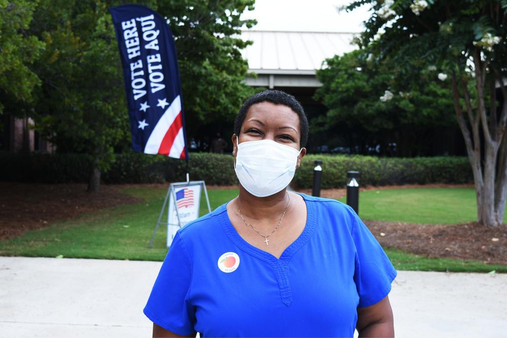Angela Maddox after voting in a primary runoff in August.