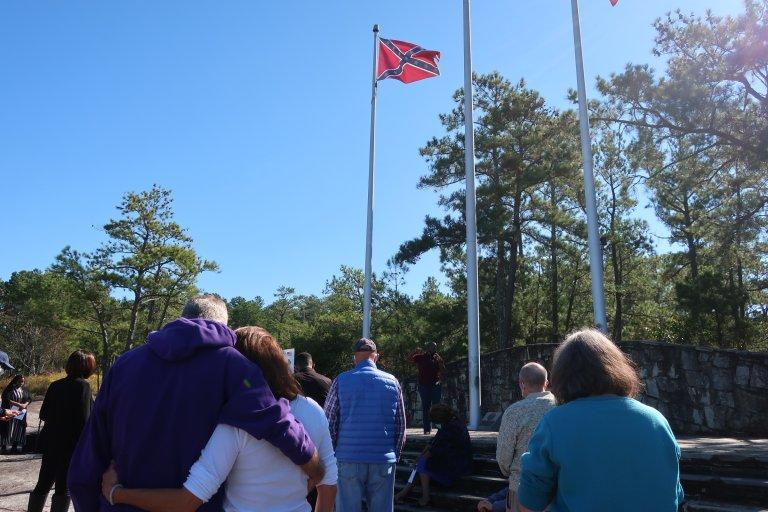 """A """"prayer for our park"""" event was held Tuesday as advocates press for the removal of Confederate flags from the park and other changes."""