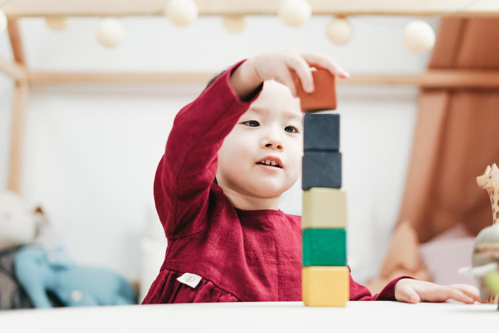 A child plays with stacking blocks