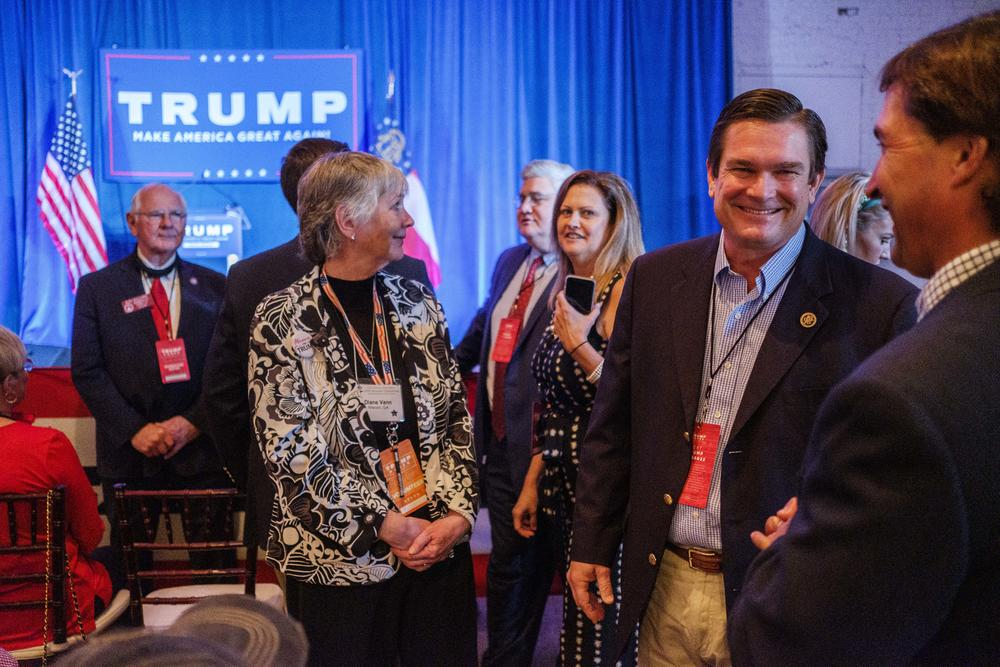 House Rep. Austin Scott, R GA-08, second from right, during a campaign visit to Macon by Donald Trump Jr. in October. According to the Atlanta Journal-Constitution, Scott has tested positive for the coronavirus.