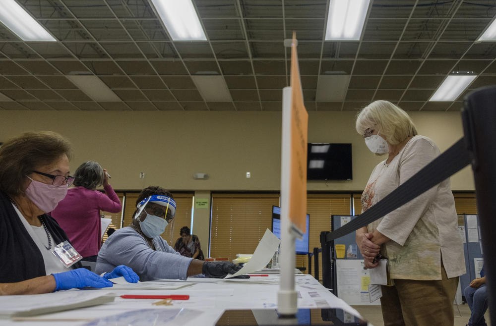 A poll watcher, right, and an auditing team, left, in the Bibb County Board of Elections in Macon on Monday, November 16. Monday was the third day  of the Georgia presidential ballot recount in Bibb County. Auditors began the day a little over halfway through 71,000 ballots.