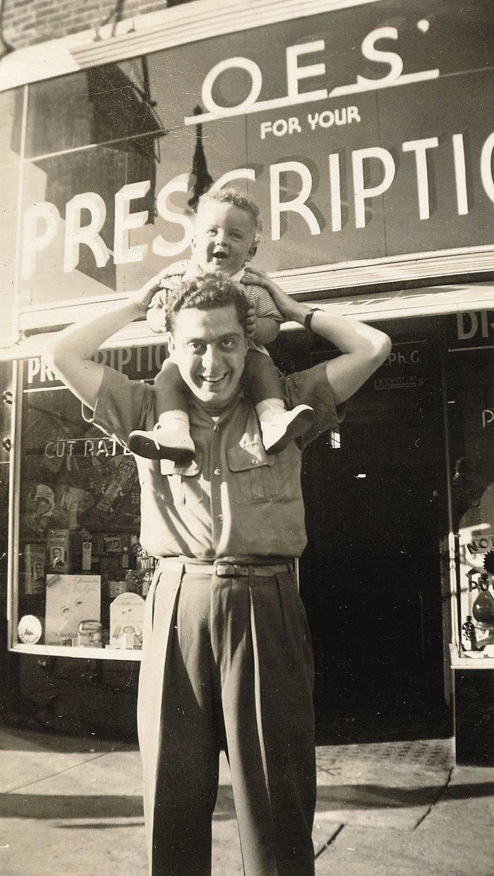 Arthur Blank's brother, Michael, and his father, Max, stand outside the OES Pharmacy family business, in 1940. Max died when Arthur was 15, leaving his mother to grow what became a multi-million-dollar business.   Photo courtesy of AMBSE Creative.