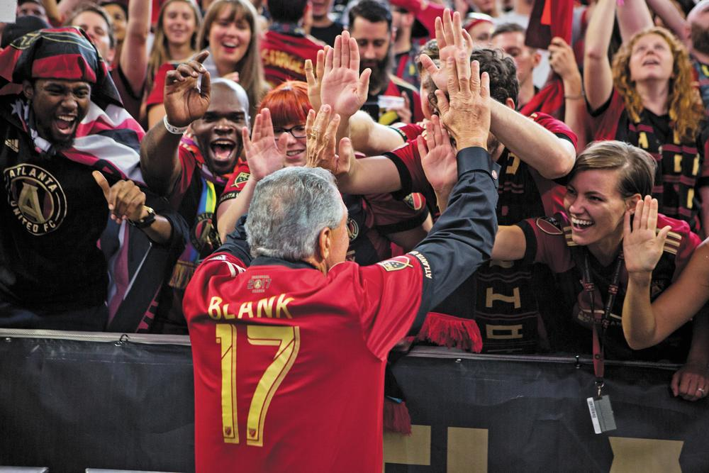 Arthur Blank greets a crowd of cheering Atlanta United fans in 2017.   Photo credit: AJ Reynolds/AMBSE Creative