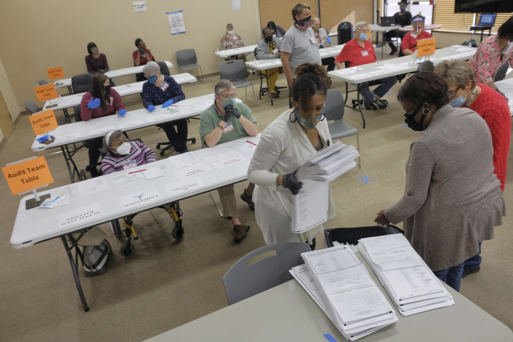 Absentee ballots are unpacked for audit in Macon.