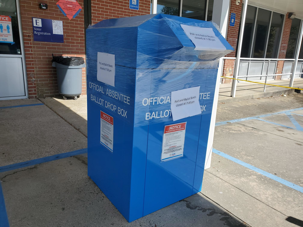 A ballot dropbox outside the Chatham County Board of Elections headquarters in Savannah, now sealed, with notices that polling closed at 7 p.m. on election day.