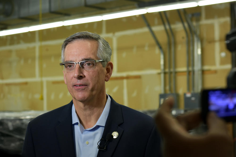 Republican Secretary of State Brad Raffensperger gives an interview inside a voting machine warehouse Dec. 2019.