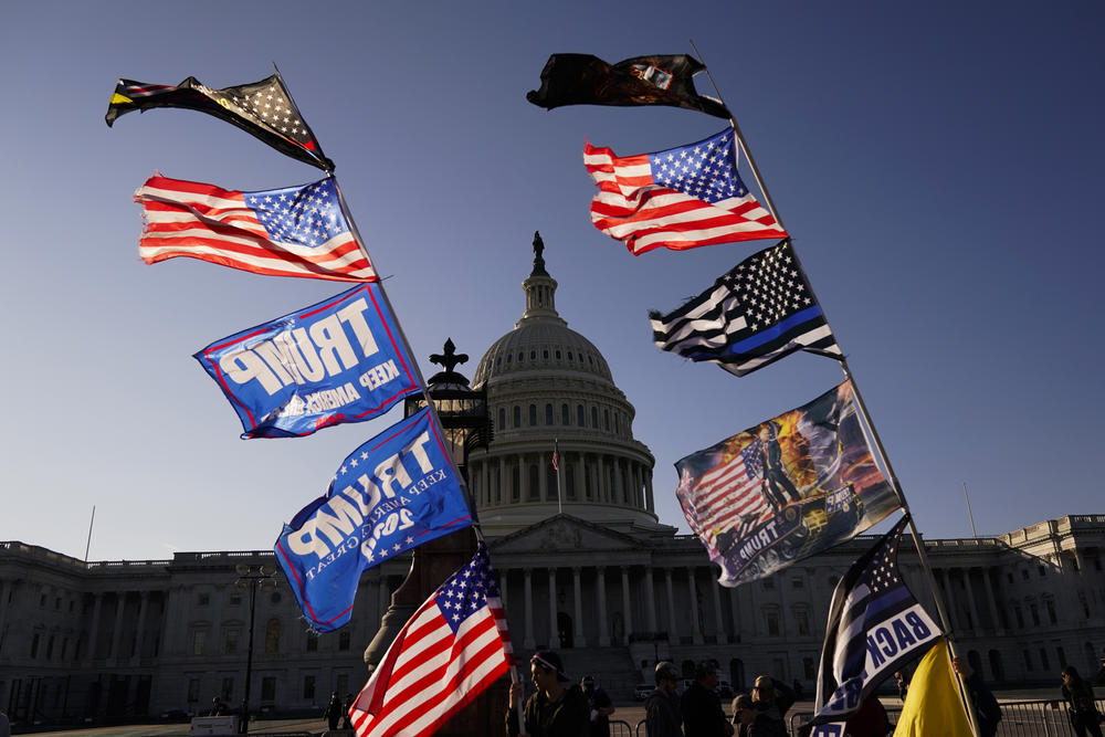 With the U.S. Capitol in the background, flags fly as supporters of President Donald Trump attend pro-Trump marches, Saturday Nov. 14, 2020, in Washington.