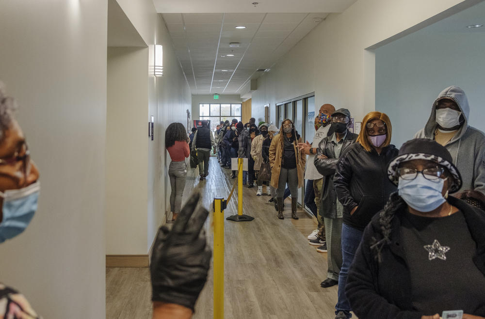 The line for early voting at the Lucas Senior Center in Macon stretched out the front door on the first day of early voting Monday.