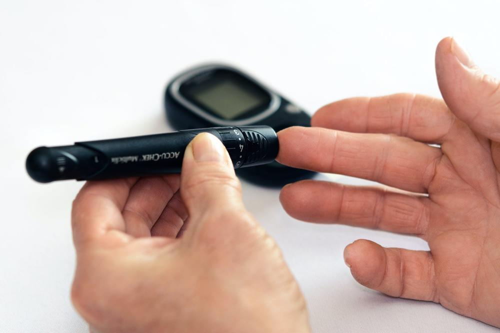 Person testing blood sugar