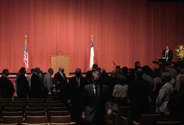 Gov. Kemp leaves funeral for DNR employee
