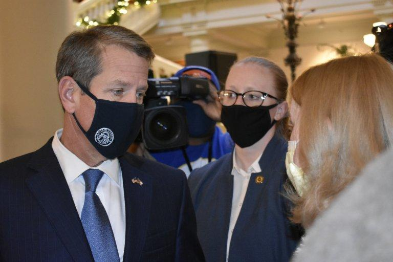Gayle Troyer of Forsyth County asks Gov. Brian Kemp to call the Legislature into special session in the Georgia Capitol Tuesday.