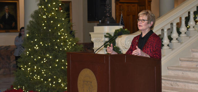 Dr. Kathleen Toomey addresses the media Tuesday
