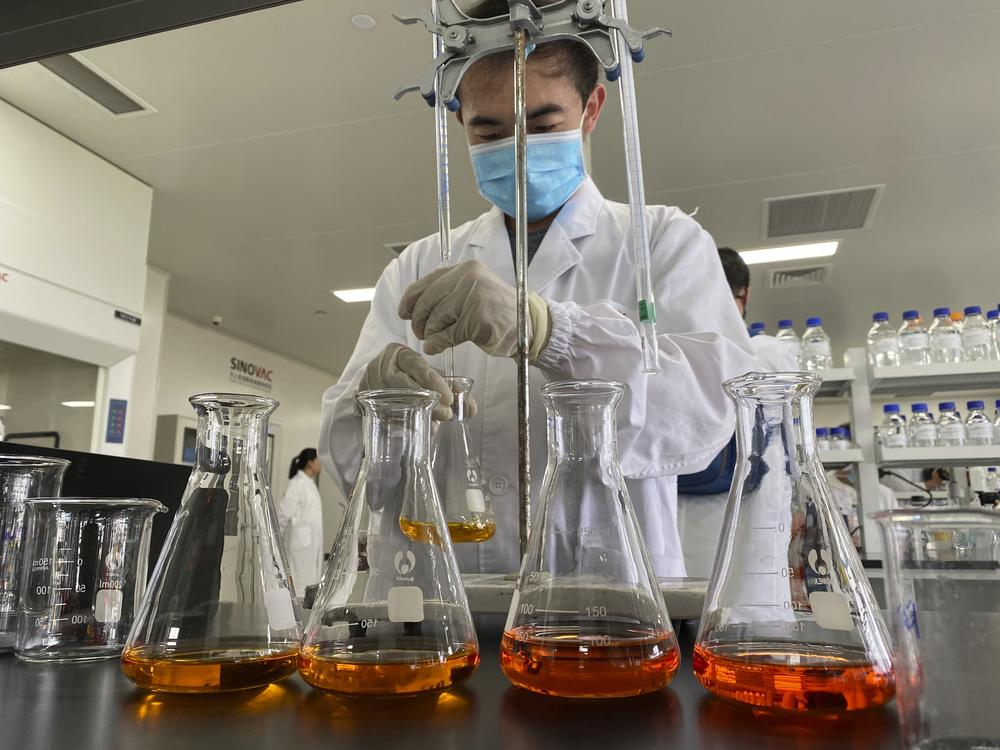 A worker works inside a lab at the SinoVac vaccine factory in Beijing on Thursday, Sept. 24, 2020. SinoVac, one of China's pharmaceutical companies behind a leading COVID-19 vaccine candidate says its vaccine will be ready by early 2021 for distribution worldwide, including the U.S.